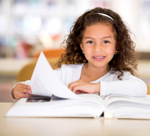 A young girl learning to read
