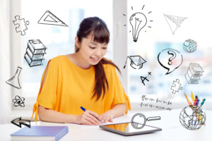 Image of a student Writing