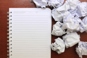 image of a notebook and crumpled papers around it