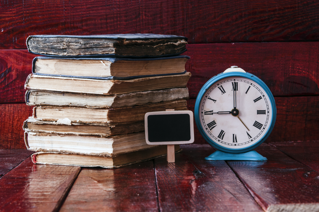 Image of a clock and an old book