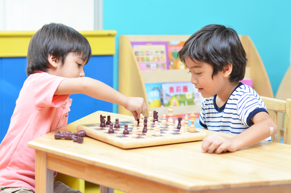 Image of two kids playing Chess.