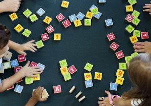 Students playing with letter blocks
