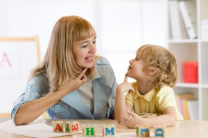 Teacher and child working on letter sounds