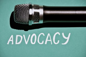 The word Advocacy under the image of a microphone